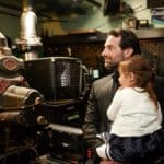 Kevin Makely and daughter in projection room at Avalon Casino